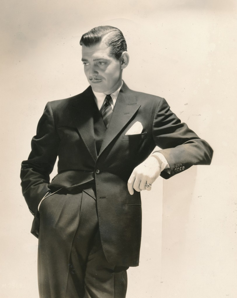 If Garbo is the most popular female movie star ever, then CLARK GABLE has to be the world's favorite male cinema actor. This portrait still of a dapper, 33-year-old Gable is a rare piece of publicity from the 1935 film, After Office Hours. This photograph makes it easy to see Gable's intense sex appeal that still smolders today. (c) MGM