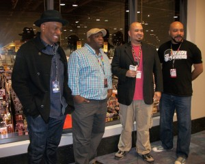 Some of the panelists of the fantastic C2E2 presentation American Culture and the Black Male image. Left to right: Eric Dean Seaton, Stacey Robinson, interviewer, and John Jennings.